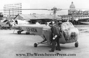 Colonel C. J. Tippett and Joe Mashman set first in flight records in helicopters in 1947.